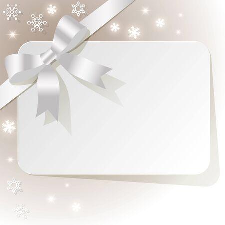 ruban blanc: Carte-cadeau avec un ruban blanc sur un fond beige avec des flocons de neige