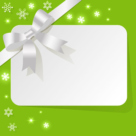 ruban blanc: Gift Card with white ribbon on a green background with snowflakes