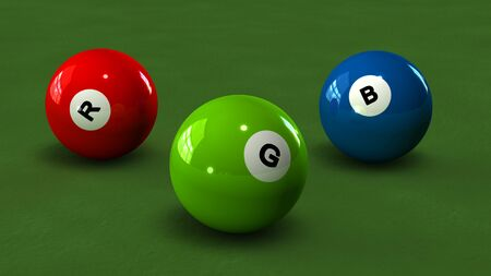 4 color printing: Billiard balls with letters RGB on a green background Stock Photo