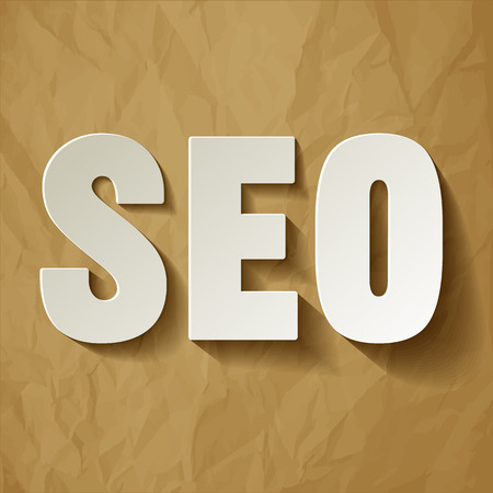 SEO white symbol on a crumpled paper brown background