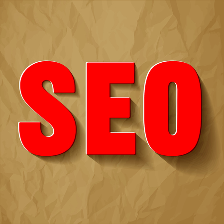 SEO symbol on a red crumpled paper brown background