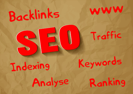trading questions: SEO symbol red paper on crumpled paper brown background