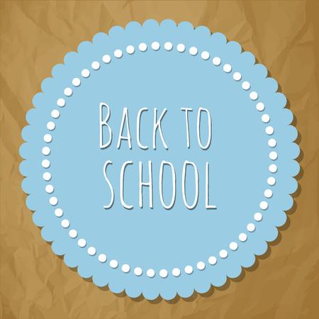 Volver a la etiqueta azul redonda escuela con puntos en un fondo de papel marrón arrugado.