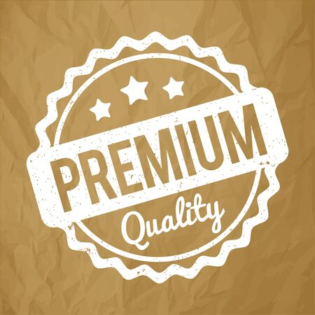 recompense: Premium Quality rubber stamp white on a crumpled paper brown background.
