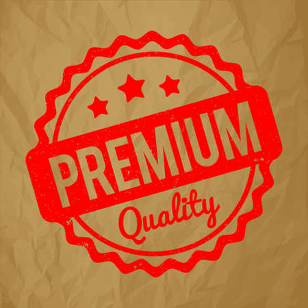 recompense: Premium Quality rubber stamp red on a crumpled brown paper background.