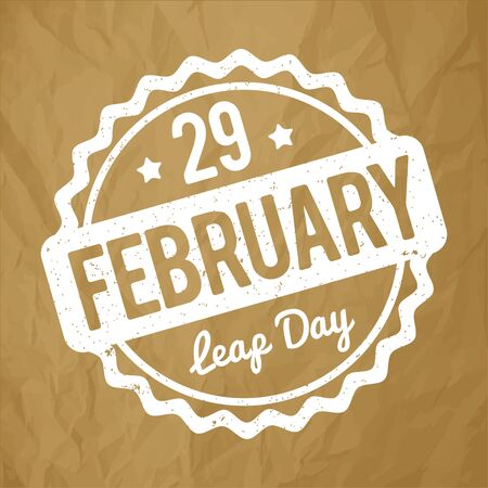 leap: 29 February Leap Day rubber stamp white on a crumpled paper brown background.