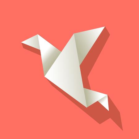 Oiseau en papier origami blanc sur fond de couleur corail