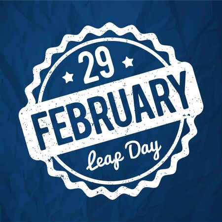29 February Leap Day rubber stamp in English white on a 2020 Classic Blue crumpled paper background