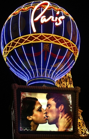 LAS VEGAS - OCT 31  Taken in Las Vegas, Nevada October 31, 2008 on the strip at night  The Paris balloon with a couple kissing and the Eiffel Tower restaurant in the background