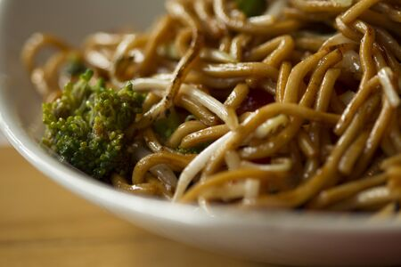 makro: Plate with chinese noodles with broccoli makro view