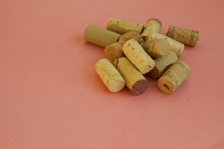 big cork: Heap of different corks on pink background