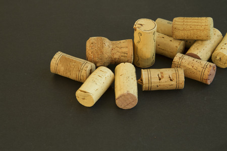 Heap of different corks on black background
