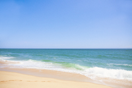 panoramas: The coast of blue ocean and sand beach with blue sky
