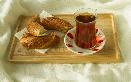 bedcover: Bagel and cup of turkish tea on the wood tray with Istanbul picture on the bedcover