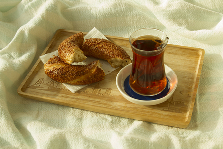 bedcover: Morning tea, Bagel and cup of turkish tea on the wood tray with Istanbul picture on the bedcover