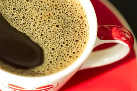 frothy: Red cup of coffee  with foam close view