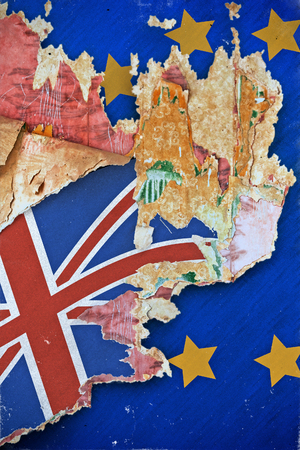 urban decay: Grunge paper with UK flag on the wallpaper break away from the European Union. Concept Brexit. Old grunge tattered wall cover in a ruined house.