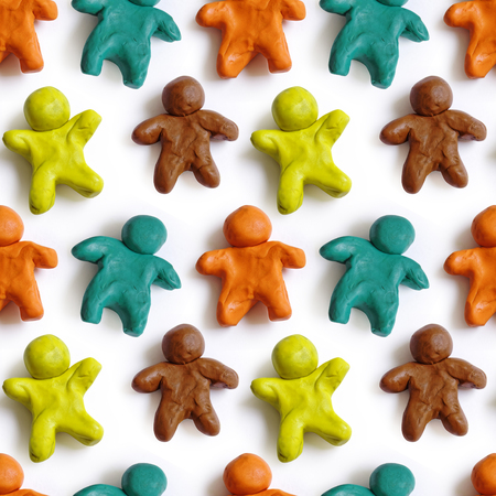 modeling clay: Seamless pattern of colorful plasticine peoples isolated on white background. Rainbow modeling clay texture. Stock Photo