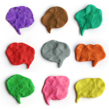 Set of plasticine colorful speech bubbles. Modeling clay handmade talk clouds isolated on white background.