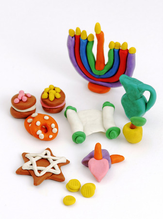 gelt: Hanukkah handmade plasticine toys. Modeling clay colorful texture. Isolated on white background.