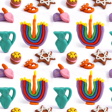 modeling clay: Hanukkah seamless handmade plasticine pattern. Modeling clay colorful texture. Isolated on white background.