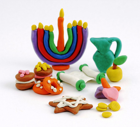 Hanukkah handmade plasticine toys. Modeling clay colorful texture. Isolated on white background.