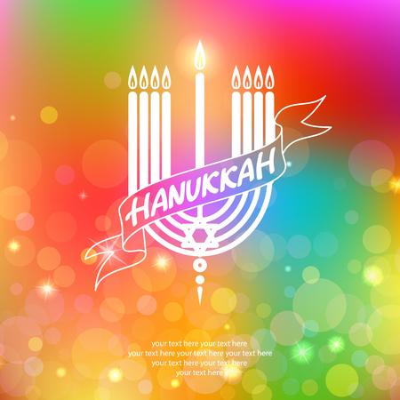 Happy Hanukkah lettering on blur bokeh background.