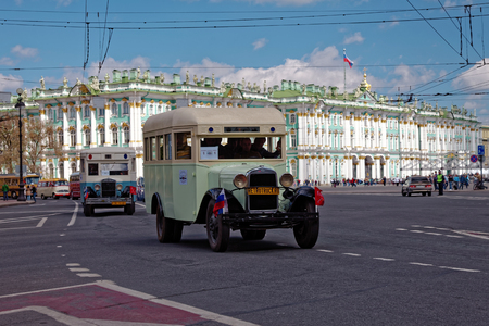 first day: SAINT-PETERSBURG, RUSSIA - 21 MAY 2017: Parade of vintage cars. Old automobiles. Tinted photo
