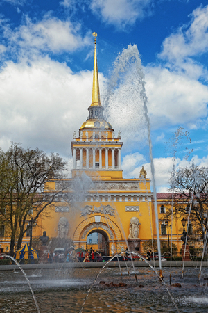 Admiralty building in the center of St. Petersburg, Russia. Fountain in front of the tower in sunny day. Tinted photo