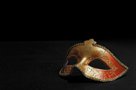 Golden Mardi Gras or Carnival mask isolated on a black background