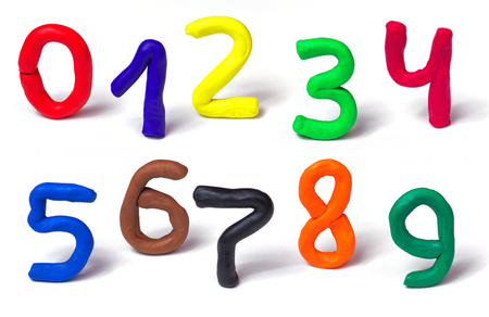Colorful plasticine numbers set isolated on a white background. Hand made modeling clay