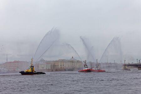 SAINT-PETERSBURG, RUSSIA - APRIL 29, 2018: Dancing tugboats on the Neva River. Marine festival of icebreakers in St. Petersburg 에디토리얼