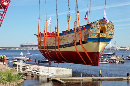 SAINT-PETERSBURG, RUSSIA - 27 MAY 2018: Ceremony of launching a replica of the ancient Russian ship of Tsar Peter I Poltava in Historical Shipyard.