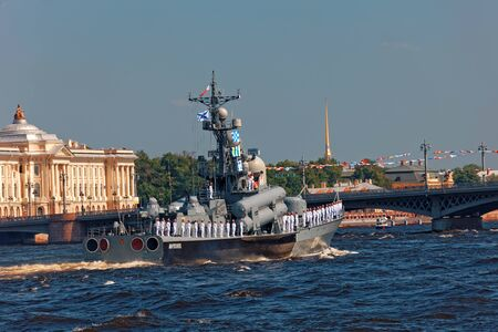 SAINT-PETERSBURG, RUSSIA - JULY 29, 2018: Warships and combat aircraft parade on the Neva river. Day of the Russian Navy