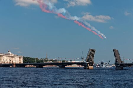 SAINT-PETERSBURG, RUSSIA - JULY 29, 2018: Warships parade on the Neva river. Day of the Russian Navy. Combat aircraft in sky