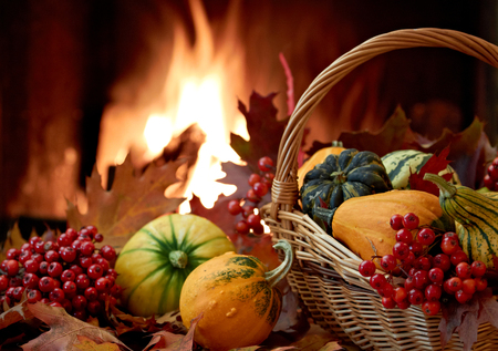 Autumn nature concept with colorful pumpkins in basket photo