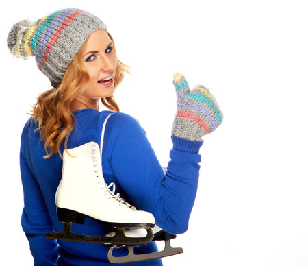 Beautiful happy young woman goes ice-skating photo