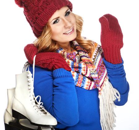 iceskating: Beautiful happy young woman goes ice-skating Stock Photo