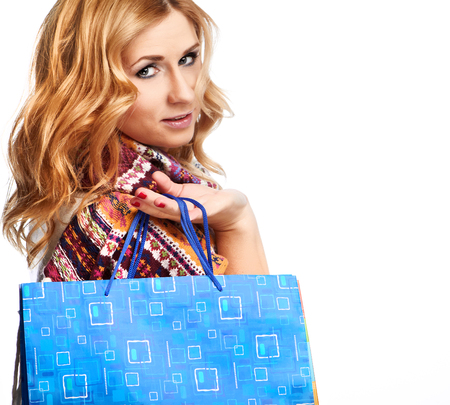 Winter and christmas shopping  Woman holding shopping bags  photo