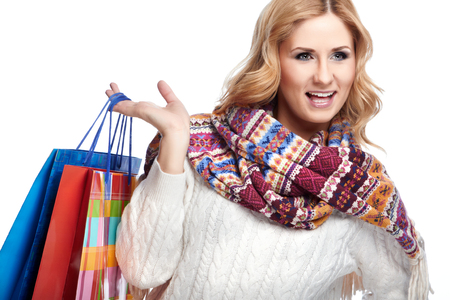 Winter and christmas shopping. Woman holding shopping bags  photo
