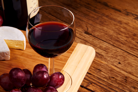 A red glass of wine and cheese  photo
