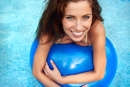 Beautiful young smiling woman in the pool  photo