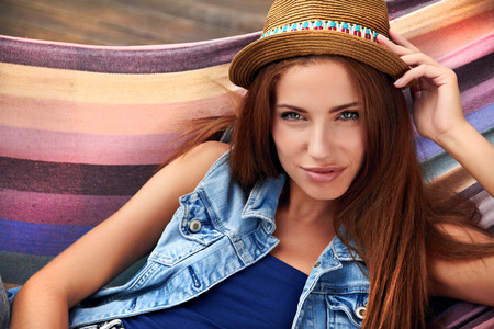 beautiful young woman resting in a hammock Stock Photo - 30529552