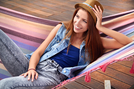 beautiful young woman resting in a hammock Stock Photo - 30529555