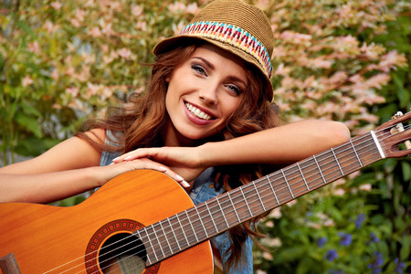 Country hippie girl with guitar photo