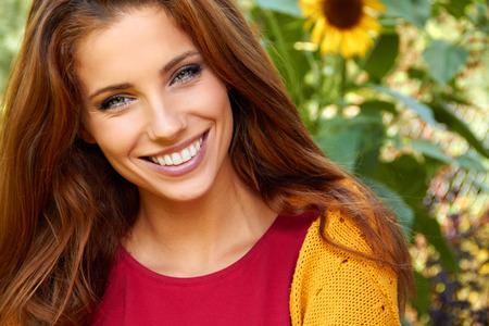 beautiful woman in an autumn garden photo