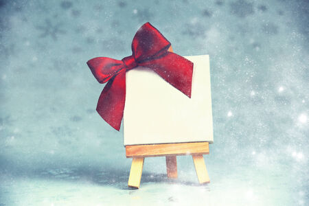 blank canvas: wooden easel with blank canvas on christmas background Stock Photo