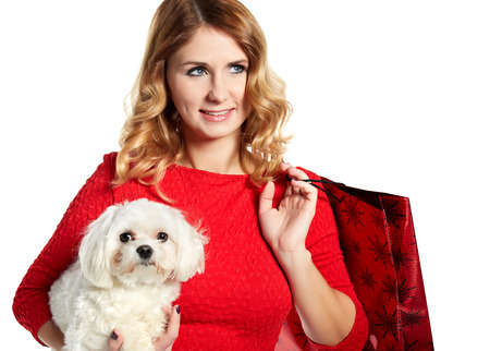beautiful young woman and a sweet little white dog. Shopping photo