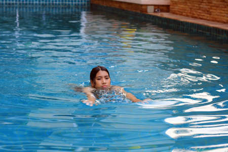 sports and recreation: woman swimming in the pool Stock Photo