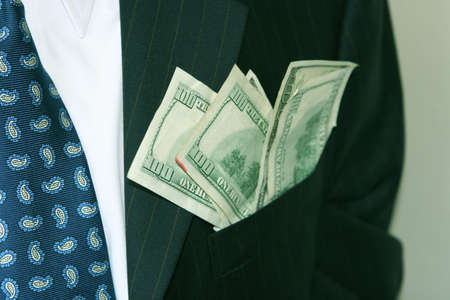 business man with money in his pocket Stock Photo
